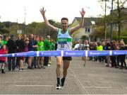 22 April 2018; Conor Dooney of Raheny Shamrocks, crossing the line to win the Senior men's relay event during the Irish Life Health National Road Relay Championships at Raheny in Dublin. Photo by Eóin Noonan/Sportsfile