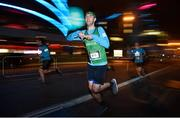 22 April 2018; Aidan Little makes his way past the Convention Centre during the KBC Night Run on North Wall Quay in Dublin.  Photo by David Fitzgerald/Sportsfile