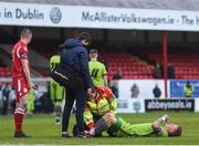 24 April 2018; Lloyd Buckley of Drogheda United is treated by medical staff during the EA SPORTS Cup Second Round match between Shelbourne and Drogheda United at Tolka Park in Dublin. Photo by Eóin Noonan/Sportsfile