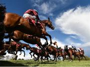 25 April 2018; A general view of the field as they jump the sixth during the Adare Manor Opportunity Series Final Handicap Hurdle at Punchestown Racecourse in Naas, Co. Kildare. Photo by Seb Daly/Sportsfile