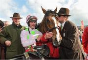 26 April 2018; Willie Mullins and jockey David Mullins look on as Owner Rich Ricci kisses Faugheen after winning the Ladbrokes Champion Stayers Hurdle at Punchestown Racecourse in Naas, Co. Kildare. Photo by Matt Browne/Sportsfile