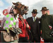 26 April 2018; Rich Ricci and Willie Mullins look on as David Mullins kisses Faugheen after winning the Ladbrokes Champion Stayers Hurdle at Punchestown Racecourse in Naas, Co. Kildare. Photo by Matt Browne/Sportsfile