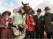 26 April 2018; Maureen Mullins along with Rich Ricci, second from right, and her son Willie Mullins look on as David Mullins kisses Faugheen after winning the Ladbrokes Champion Stayers Hurdle at Punchestown Racecourse in Naas, Co. Kildare. Photo by Matt Browne/Sportsfile