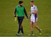26 April 2018; Injured Kilmacud Crokes Player Cian O'Sullivan talks to Paul Mannion during the Dublin County Senior Football Championship Group 1 match between Kilmacud Crokes and St Oliver Plunkett's at Parnell Park in Dublin. Photo by Harry Murphy/Sportsfile