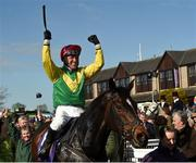 27 April 2018; Jockey Robbie Power celebrates as he enters the winners' enclosure after winning The BETDAQ 2% Commission Punchestown Champion Hurdle on Supasundae at Punchestown Racecourse in Naas, Co. Kildare. Photo by Matt Browne/Sportsfile