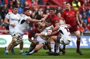 28 April 2018; Stuart McCloskey of Ulster is tackled by Munster players, from left, JJ Hanrahan, Conor Oliver, and Dan Goggin during the Guinness PRO14 Round 21 match between Munster and Ulster at Thomond Park in Limerick. Photo by Diarmuid Greene/Sportsfile