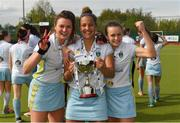 28 April 2018; UCD players, from left, Deirdre Duke, Elena Tice, and Ellen Curran celebrate with the cup after the Women's EY Hockey League match between UCD and Monkstown at UCD in Belfield, Dublin. Photo by Piaras Ó Mídheach/Sportsfile