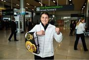 30 April 2018; Katie Taylor, who won both the WBA and IBF World Lightweight World Champion belts on Saturday night,  with the Unified WBA belt on her arrival home at Dublin Airport, Dublin. Photo by David Fitzgerald/Sportsfile