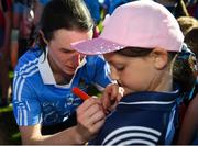 6 May 2018; Sinead Aherne of Dublin signs the jersey of young Dublin supporter Clodagh Parsons, age 7, after the Lidl Ladies Football National League Division 1 Final match between Dublin and Mayo at Parnell Park in Dublin. Photo by Tom Beary/Sportsfile
