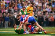 6 May 2018; Paddy Maguire, left, Micheal McWeeney and Diarmuid McKiernan, right, of Leitrim with Luke Kelly, 12, and Jamie Clarke of New York during the Connacht GAA Football Senior Championship Quarter-Final match between New York and Leitrim at McGovern Park at Gaelic Park in New York, USA. Photo by Stephen McCarthy/Sportsfile