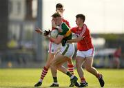 8 May 2018; Darragh Lyne of Kerry is tackled by Conor Corbett, left, and Eoin Nation of Cork during the Electric Ireland Munster GAA Football Minor Championship semi-final match between Kerry and Cork at Austin Stack Park, in Tralee, Kerry.  Photo by Eóin Noonan/Sportsfile