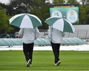 11 May 2018; Umpires Richard Illingworth, left, and Nigel Llong, right, take to the field to inspect the surface, before deciding to abandon play on day one of the International Cricket Test match between Ireland and Pakistan at Malahide, in Co. Dublin. Photo by Seb Daly/Sportsfile
