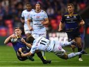 12 May 2018; Luke McGrath of Leinster is tackled by Marc Andreu of Racing 92 during the European Rugby Champions Cup Final match between Leinster and Racing 92 at the San Mames Stadium in Bilbao, Spain. Photo by Stephen McCarthy/Sportsfile
