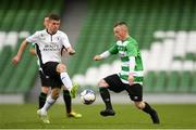 12 May 2018; Adrian Rafferty of Firhouse Clover in action against Daniel Burke of Maynooth University Town during the FAI New Balance Intermediate Cup Final match between Firhouse Clover and Maynooth University Town at the Aviva Stadium in Dublin. Photo by Eóin Noonan/Sportsfile