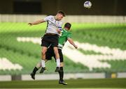 12 May 2018; Jake Corrigan of Maynooth University Town in action against Gerry Bambrick of Firhouse Clover during the FAI New Balance Intermediate Cup Final match between Firhouse Clover and Maynooth University Town at the Aviva Stadium in Dublin. Photo by Eóin Noonan/Sportsfile