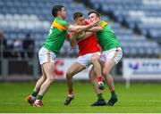 13 May 2018; Seán Murphy of Carlow in action against Ryan Burns and Eoghan Ruth of Carlow during the Leinster GAA Football Senior Championship Preliminary Round match between Louth and Carlow at O'Moore Park in Laois. Photo by Harry Murphy/Sportsfile