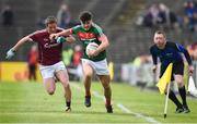 13 May 2018; Cian Bourke of Mayo in action against Aongus Ó hlarnáin of Galway during the Junior Championship Final match between Mayo and Galway at Elvery's MacHale Park in Mayo. Photo by David Fitzgerald/Sportsfile