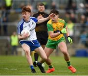 13 May 2018; Sean Jones of Monaghan in action against Matthew Mullholland of Donegal during the 2018 Ulster GAA Football U17 Championship Qualifiers Round 2 match between Donegal and Monaghan at Páirc MacCumhaill in Donegal. Photo by Philip Fitzpatrick/Sportsfile