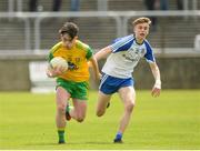 13 May 2018; Dylan Doogan in action against Karl Gallagher of Monaghan during the 2018 Ulster GAA Football U17 Championship Qualifiers Round 2 match between Donegal and Monaghan at Páirc MacCumhaill in Donegal. Photo by Oliver McVeigh/Sportsfile