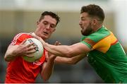 13 May 2018; Declan Byrne of Louth in action against Daniel St Ledger of Carlow during the Leinster GAA Football Senior Championship Preliminary Round match between Louth and Carlow at O'Moore Park in Laois. Photo by Piaras Ó Mídheach/Sportsfile