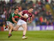 13 May 2018; Pádraic Cunningham of Galway in action against James O'Dowd of Mayo during the Junior Championship Semi-Final match between Mayo and Galway at Elvery's MacHale Park in Mayo. Photo by Eóin Noonan/Sportsfile