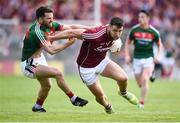 13 May 2018; Damien Comer of Galway in action against Chris Barrett of Mayo during the Connacht GAA Football Senior Championship Quarter-Final match between Mayo and Galway at Elvery's MacHale Park in Mayo. Photo by David Fitzgerald/Sportsfile