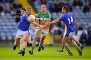 13 May 2018; Conor Carroll of Offaly in action against Dean Healy and John McGrath of Wicklow during the Leinster GAA Football Senior Championship Preliminary Round match between Offaly and Wicklow at O'Moore Park in Laois. Photo by Harry Murphy/Sportsfile