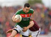 13 May 2018; Kevin McLoughlin of Mayo is tackled by Damien Comer of Galway during the Connacht GAA Football Senior Championship Quarter-Final match between Mayo and Galway at Elvery's MacHale Park in Mayo. Photo by Eóin Noonan/Sportsfile