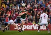 13 May 2018; Diarmuid O'Connor of Mayo scores a point for his side despite the efforts of Johnny Heaney of Galway during the Connacht GAA Football Senior Championship Quarter-Final match between Mayo and Galway at Elvery's MacHale Park in Mayo. Photo by Eóin Noonan/Sportsfile