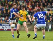13 May 2018; Michael Langan of Donegal in action against Killian Clarke of Cavan during the Ulster GAA Football Senior Championship Preliminary Round match between Donegal and Cavan at Páirc MacCumhaill in Donegal. Photo by Oliver McVeigh/Sportsfile