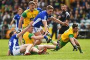 13 May 2018; Leo McLoone of Donegal in action against Gearoid McKiernan and Killian Clarke of Cavan during the Ulster GAA Football Senior Championship Preliminary Round match between Donegal and Cavan at Páirc MacCumhaill in Donegal. Photo by Oliver McVeigh/Sportsfile