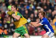 13 May 2018; Caolan Ward of Donegal in action against Jason McLoughlin of Cavan during the Ulster GAA Football Senior Championship Preliminary Round match between Donegal and Cavan at Páirc MacCumhaill in Donegal. Photo by Philip Fitzpatrick/Sportsfile