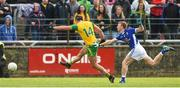 13 May 2018; Michael Murphy of Donegal with a shot on goal despite the tackle of Ciaran Brady of Cavan during the Ulster GAA Football Senior Championship Preliminary Round match between Donegal and Cavan at Páirc MacCumhaill in Donegal. Photo by Oliver McVeigh/Sportsfile