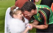 13 May 2018; Carlow goalkeeping coach John Corcoran his daughter Róisín Corcoran, age 7, in her Communion dress, after the Leinster GAA Football Senior Championship Preliminary Round match between Louth and Carlow at O'Moore Park in Laois. Photo by Piaras Ó Mídheach/Sportsfile