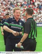 3 August 2003; Dominic Corrigan, Fermanagh manager, shakes hands with the referee Pat McEnaney. Bank of Ireland All-Ireland Senior Football Championship Quarter Final, Tyrone v Fermanagh, Croke Park, Dublin. Picture credit; Damien Eagers / SPORTSFILE. *EDI*
