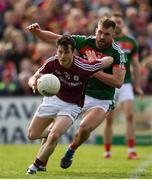 13 May 2018; Ian Burke of Galway in action against Aidan O'Shea of Mayo during the Connacht GAA Football Senior Championship Quarter-Final match between Mayo and Galway at Elvery's MacHale Park in Mayo. Photo by Eóin Noonan/Sportsfile