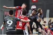 14 May 2018; Brian Gartland, centre, of Dundalk heads to score his side's first goal during the SSE Airtricity League Premier Division match between Derry City and Dundalk at the Brandywell Stadium in Derry. Photo by Oliver McVeigh/Sportsfile