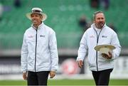 15 May 2018; Umpire Nigel Llong, left, and Richard Illingworth following play on day five of the International Cricket Test match between Ireland and Pakistan at Malahide, in Co. Dublin. Photo by Seb Daly/Sportsfile