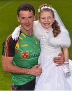 13 May 2018; Carlow goalkeeping coach John Corcoran with his daughter Róisín Corcoran, age 7, in her Communion dress, after the Leinster GAA Football Senior Championship Preliminary Round match between Louth and Carlow at O'Moore Park in Laois. Photo by Piaras Ó Mídheach/Sportsfile
