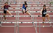 17 May 2018; Aoibhe Deeley of St Killians New Inn, Co. Galway, left, with Saoirse Wynn of Abbey Community College, Co. Roscommon and Cian Burke of Ballyhaunis Community School, Co. Mayo competing in the Inter Girls 80m Hurdles event during the Irish Life Health Connacht Schools Track and Field event at Athlone I.T., Athlone, Co. Westmeath. Photo by Harry Murphy/Sportsfile