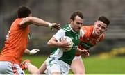 19 May 2018; Declan McCusker of Fermanagh in action against Brendan Donaghy, left, and Ben Crealey of Armagh during the Ulster GAA Football Senior Championship Quarter-Final match between Fermanagh and Armagh at Brewster Park in Enniskillen, Fermanagh. Photo by Oliver McVeigh/Sportsfile