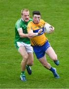 19 May 2018; Keelan Sexton of Clare in action against Seán O'Dea of Limerick during the Munster GAA Football Senior Championship Quarter-Final match between Limerick and Clare at the Gaelic Grounds in Limerick. Photo by Piaras Ó Mídheach/Sportsfile