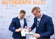 19 May 2018; Leinster players Josh van der Flier, left, and Dan Leavy sign a jersey at Autograph Alley prior to the Guinness PRO14 semi-final match between Leinster and Munster at the RDS Arena in Dublin. Photo by Stephen McCarthy/Sportsfile