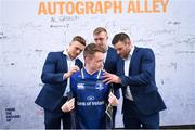 19 May 2018; A Leinster supporter has his jersey signed by Leinster players, from left, Josh van der Flier, Dan Leavy and Fergus McFadden at Autograph Alley prior to the Guinness PRO14 semi-final match between Leinster and Munster at the RDS Arena in Dublin. Photo by Stephen McCarthy/Sportsfile