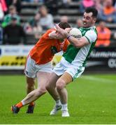 19 May 2018; Barry Mulrone of Fermanagh in action against Charlie Vernon of Armagh  during the Ulster GAA Football Senior Championship Quarter-Final match between Fermanagh and Armagh at Brewster Park in Enniskillen, Fermanagh. Photo by Oliver McVeigh/Sportsfile