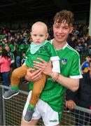 20 May 2018; Bryan Nix of Limerick with his nephew, 15 month old Conor Nix, from Newcastlewest, Limerick, after the Electric Ireland Munster GAA Hurling Minor Championship Round 1 match between Limerick and Tipperary at the Gaelic Grounds in Limerick. Photo by Ray McManus/Sportsfile