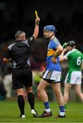 20 May 2018; Referee James McGrath issues a yellow card to John McGrath of Tipperary during the Munster GAA Hurling Senior Championship Round 1 match between Limerick and Tipperary at the Gaelic Grounds in Limerick. Photo by Ray McManus/Sportsfile