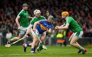 20 May 2018; John O'Dwyer of Tipperary hand passes under pressure from Limerick defenders Seamus Hickey, 3, and Richie English during the Munster GAA Hurling Senior Championship Round 1 match between Limerick and Tipperary at the Gaelic Grounds in Limerick. Photo by Ray McManus/Sportsfile