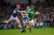 20 May 2018; Darragh O'Donovan of Limerick in action against Billy McCarthy of Tipperary during the Munster GAA Hurling Senior Championship Round 1 match between Limerick and Tipperary at the Gaelic Grounds in Limerick. Photo by Ray McManus/Sportsfile