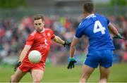 20 May 2018; Niall Sludden of Tyrone scores a point despite the attention of Ryan Wylie of Monaghan during the Ulster GAA Football Senior Championship Quarter-Final match between Tyrone and Monaghan at Healy Park in Tyrone. Photo by Oliver McVeigh/Sportsfile